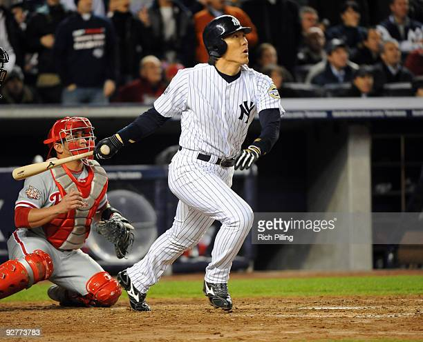 Hideki Matsui of the New York Yankees hits a twoRBI double in the bottom of the fifth inning of Game Six of the 2009 MLB World Series at Yankee...