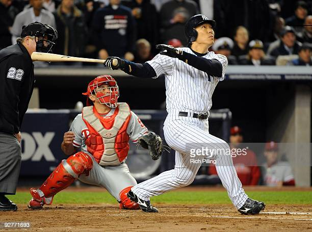 Hideki Matsui of the New York Yankees hits a tworun home run in the bottom of the second inning of Game Six of the 2009 MLB World Series at Yankee...