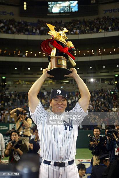Hideki Matsui of the New York Yankees holds up the MVP TrophyThe New York Yankees defeat the Tampa Bay Devil Rays 121 at the Tokyo Dome in Tokyo Japan