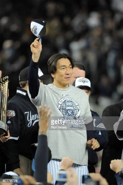 Hideki Matsui of the New York Yankees is presented with the World Series MVP trophy after the Yankees 7-3 win against the Philadelphia Phillies in...