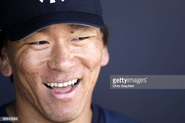 Hideki Matsui of the New York Yankees laughs as he talks with reporters during practice on February 26, 2006 at Legends Field in Tampa, Florida.