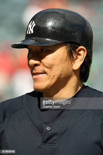 Hideki Matsui of the New York Yankees looks on during batting practice prior to the start of Game Three of the ALCS against the Los Angeles Angels of...