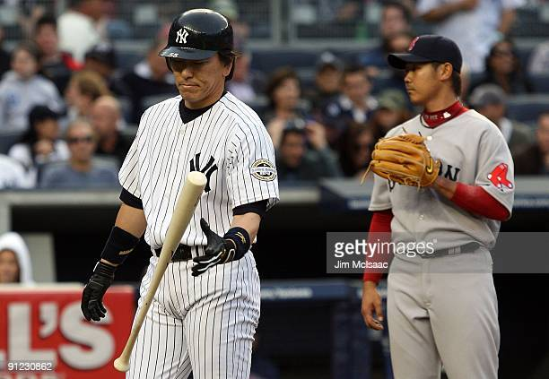 Hideki Matsui of the New York Yankees reacts after popping out with the base loaded against Daisuke Matsuzaka of the Boston Red Sox on September 26...