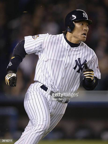 Hideki Matsui of the New York Yankees runs to first base before flying out to right field against the Florida Marlins in the fifth inning during game...
