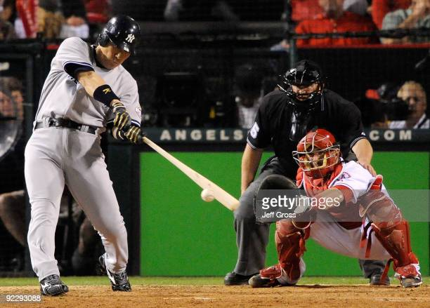 Hideki Matsui of the New York Yankees singles to center field during the seventh inning in Game Five of the ALCS against the Los Angeles Angels of...