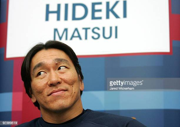Hideki Matsui of the New York Yankees talks to members of the media before the World Series workouts on October 27 2009 at Yankee Stadium in the...