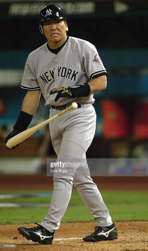 Hideki Matsui #55 of the New York Yankees throws his bat after walking during game three of the Major League Baseball World Series against the Florida Marlins on October 21, 2003 at Pro Player Stadium in Miami, Florida. The Yankees defeated the Marlins 6-1.