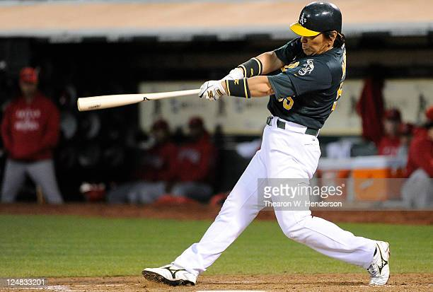 Hideki Matsui of the Oakland Athletics bats against the Los Angeles Angels of Anaheim during an MLB baseball game at Oco Coliseum on September 12...