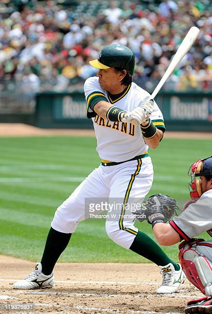 Hideki Matsui of the Oakland Athletics drives in two runs with a base hit against the Los Angeles Angels of Anaheim in the first inning during an MLB...
