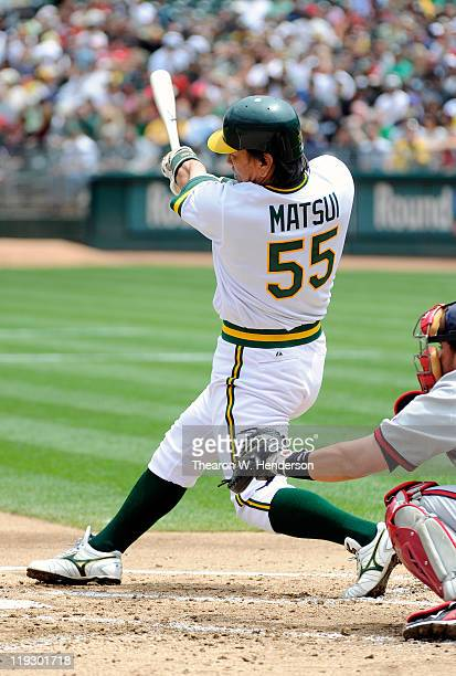 Hideki Matsui of the Oakland Athletics drives in two runs with a single against the Los Angeles Angels of Anaheim in the first inning during an MLB...