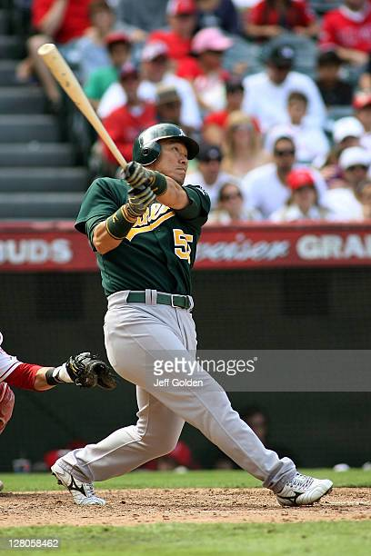 Hideki Matsui of the Oakland Athletics flies out to right field on the second pitch of his at bat against the Los Angeles Angels of Anaheim for the...