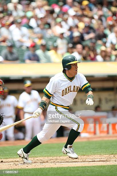 Hideki Matsui of the Oakland Athletics hits during the game against the LA Angels at the OaklandAlameda County Coliseum on July 17 2011 in Oakland...