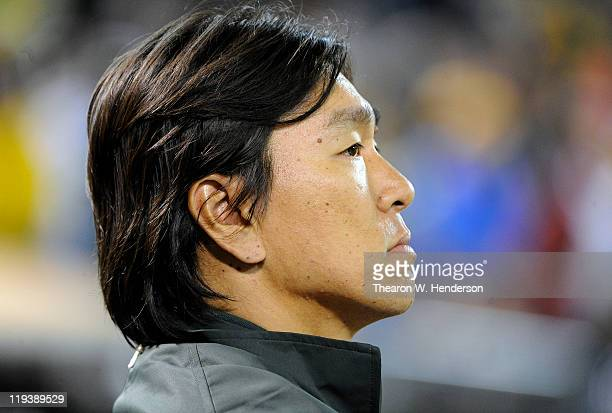 Hideki Matsui of the Oakland Athletics looks on from the end of the dugout against the Los Angeles Angels of Anaheim during an MLB baseball game at...