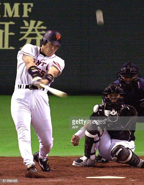 Hideki Matsui of Yomiuri Giants hits the ball for a two-run homer in the third inning of Game 6 of the Japan Series baseball championship against...