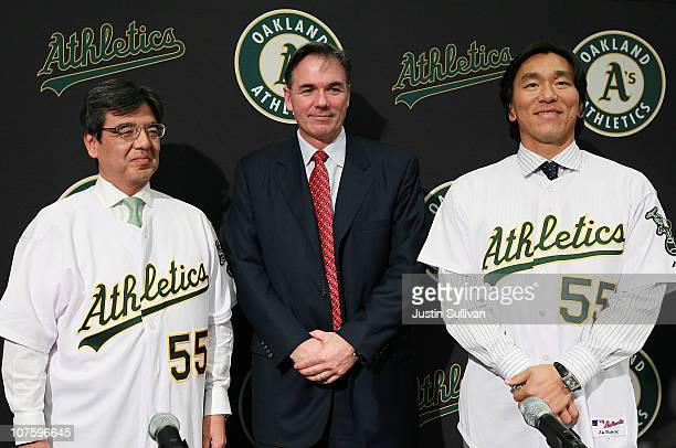 Hideki Matsui stands with Oakland Athletics general manager Billy Beane and San Francisco Consul General Hiroshi Inomata pose for a photograph during...