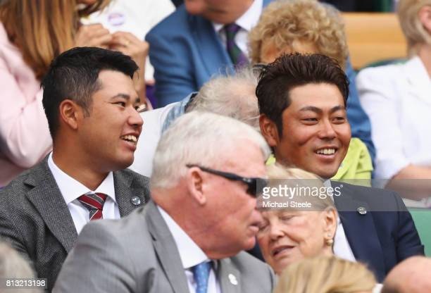 Hideki Matsuyama and Hideto Tanihara look on from the centre court royal box on day nine of the Wimbledon Lawn Tennis Championships at the All...