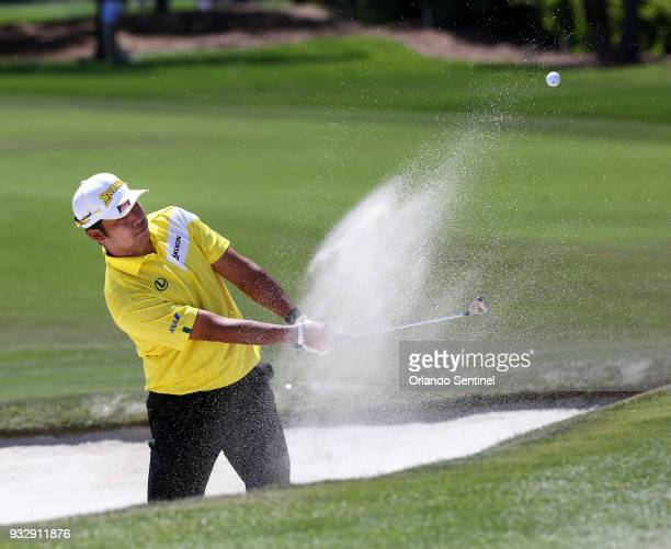 Hideki Matsuyama from Sendai Japan chips for a birdie from the bunker at the first green during the second day of the Arnold Palmer Invitational at...