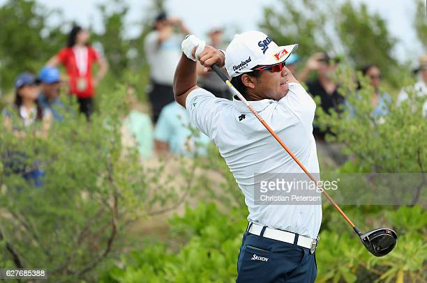 Hideki Matsuyama hits his tee shot on the first hole during the final round of the Hero World Challenge at Albany The Bahamas on December 4 2016 in...