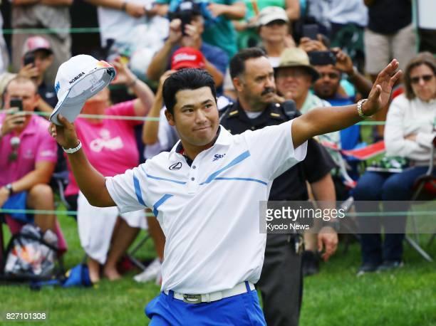 Hideki Matsuyama of Japan acknowledges the gallery after winning the World Golf ChampionshipsBridgestone Invitational by five strokes at Firestone...