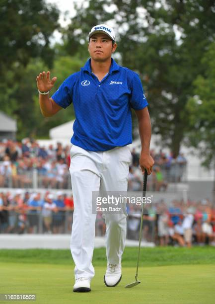 Hideki Matsuyama of Japan acknowledges the gallery on the 18th hole during the final round of the BMW Championship at Medinah Country Club on August...