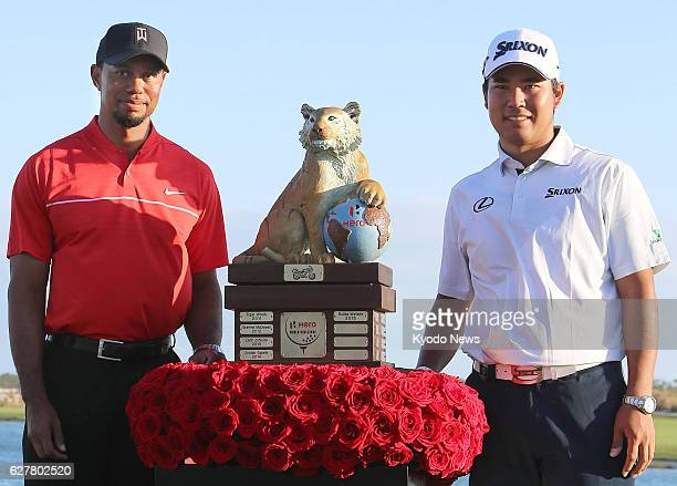 Hideki Matsuyama of Japan and American Tiger Woods pose for photos at Albany Golf Club in the Bahamas on Dec 4 after completing the final round of...