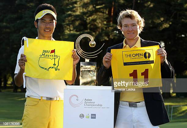 Hideki Matsuyama of Japan and Tarquin MacManus of Australia hold the flags of the Masters Tournament and British Open after the final round of the...