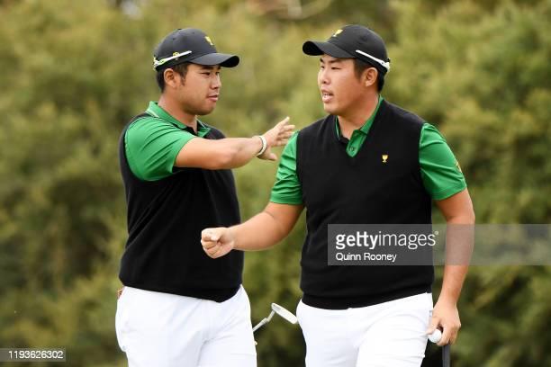 Hideki Matsuyama of Japan and the International team and ByeongHun An of South Korea and the International team celebrate on the seventh green during...