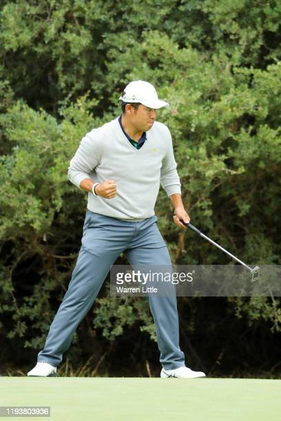 Hideki Matsuyama of Japan and the International team celebrates on the 13th green during Saturday fourball matches on day three of the 2019...