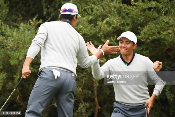 Hideki Matsuyama of Japan and the International team celebrates with CT Pan of Taiwan and the International team on the 13th green during Saturday...