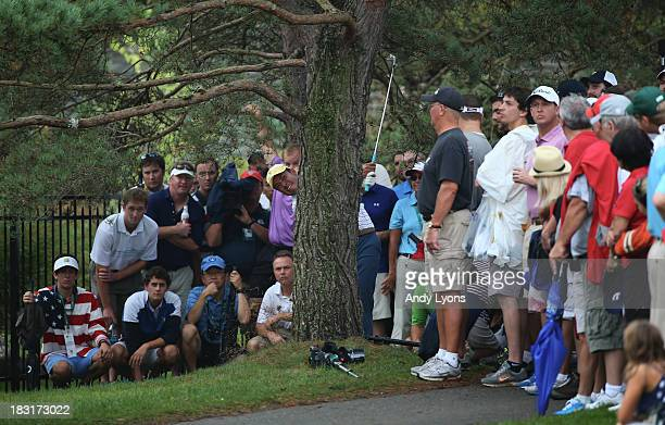 Hideki Matsuyama of Japan and the International Team hits a shot from behind a tree on the tenth hole during the Day Three Four-ball Matches at the...