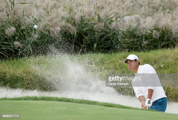 Hideki Matsuyama of Japan and the International team plays his second shot on the 10th hole in his match with Jhonattan Vegas against Daniel Berger...