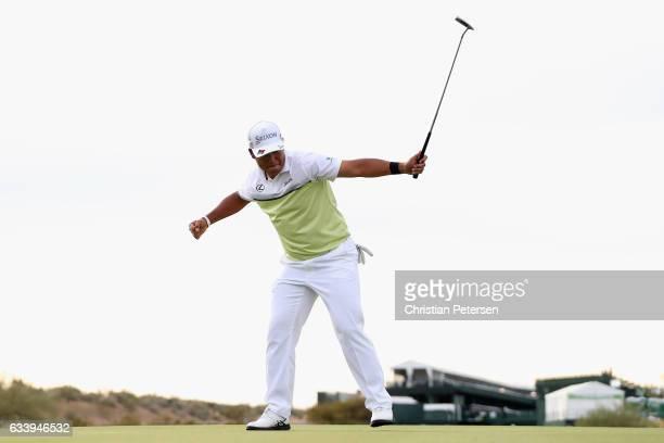 Hideki Matsuyama of Japan celebrates after winning the Waste Management Phoenix Open on the fourth playoff hole at TPC Scottsdale on February 5 2017...