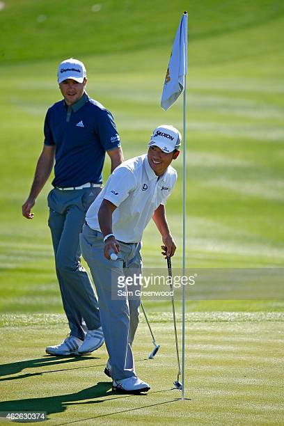 Hideki Matsuyama of Japan celebrates his eagle shot on the first hole during the fourth round of the Waste Management Phoenix Open at TPC Scottsdale...