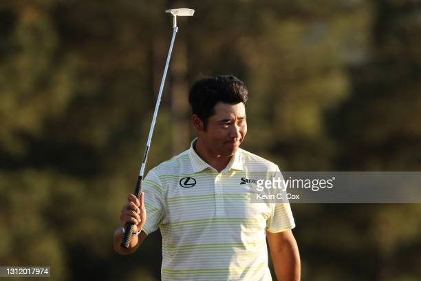 Hideki Matsuyama of Japan celebrates on the 18th green after winning the Masters at Augusta National Golf Club on April 11, 2021 in Augusta, Georgia.