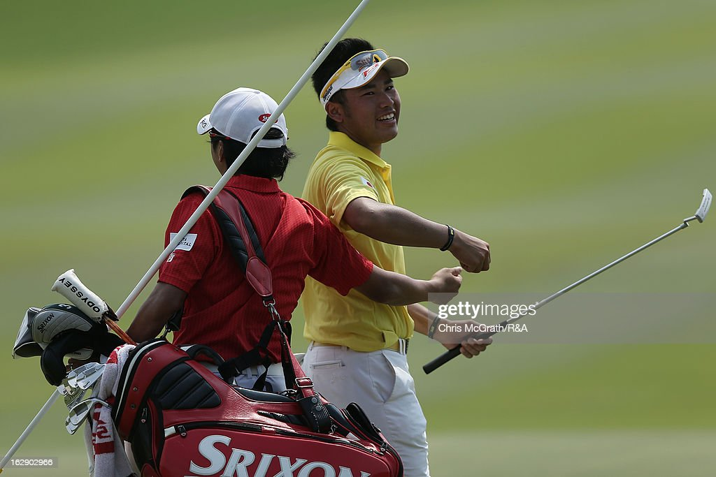 Hideki Matsuyama of Japan celebrates with his caddie on the 18th green during round two of The Open Championship International Final Qualifying Asia at Amata Springs Country Club on March 01, 2013 in Bangkok, Thailand.