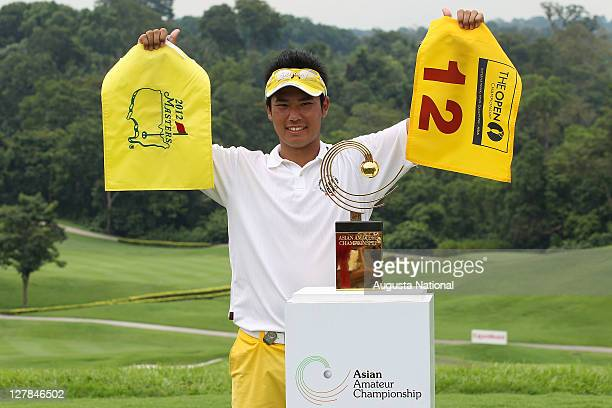 Hideki Matsuyama of Japan celebrates with the trophy after winning the Asian Amateur Championship during day four of the 2011 Asian Amateur...