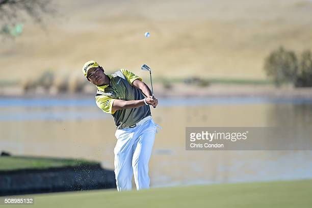 Hideki Matsuyama of Japan chips to the 15th green during the final round of the Waste Management Phoenix Open at TPC Scottsdale on February 7 2016 in...