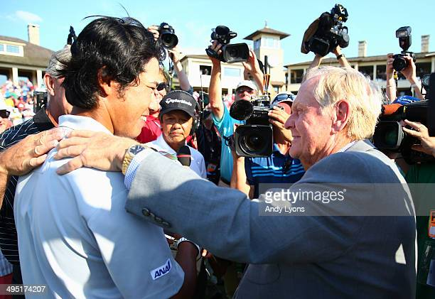 Hideki Matsuyama of Japan congratulated by Jack Nicklaus after winning the Memorial Tournament presented by Nationwide Insurance at Muirfield Village...