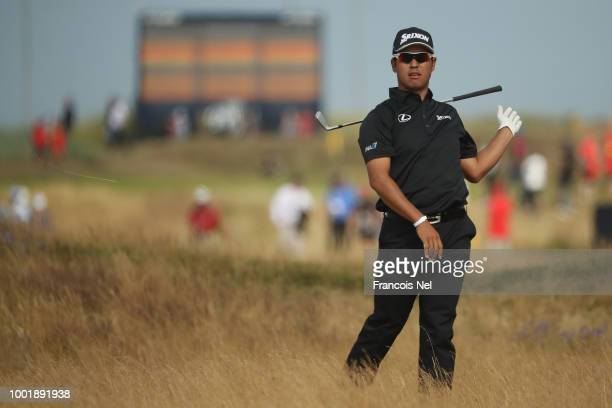 Hideki Matsuyama of Japan drops his club after a shot on the sixth hole during the first round of the 147th Open Championship at Carnoustie Golf Club...