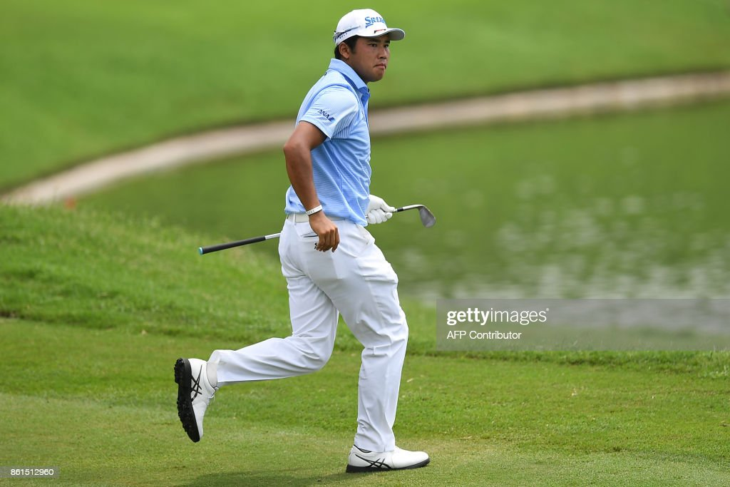 Hideki Matsuyama of Japan follows his shot on the 16th fairway during the final round of the 2017 CIMB Classic golf tournament in Kuala Lumpur on October 15, 2017. / AFP PHOTO / Mohd RASFAN