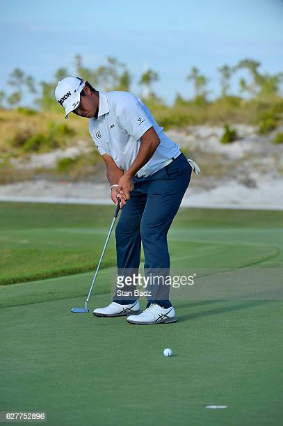 Hideki Matsuyama of Japan hits a putt on the 16th hole during the final round of the Hero World Challenge at Albany course on December 4 2016 in...