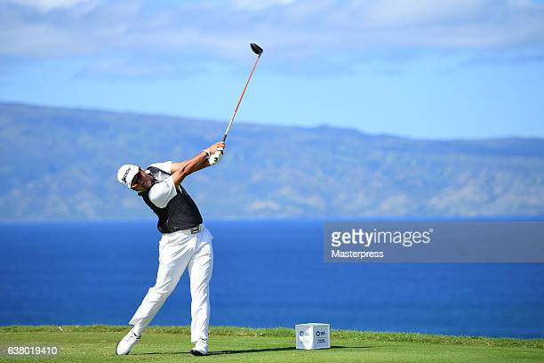 Hideki Matsuyama of Japan hits a tee shot on the 13th hole during the final round of the SBS Tournament of Champions at the Plantation Course at...