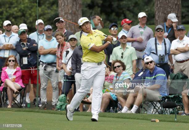 Hideki Matsuyama of Japan hits a tee shot on the 17th hole during the final round of the Masters Tournament in Augusta Georgia on April 14 2019 He...
