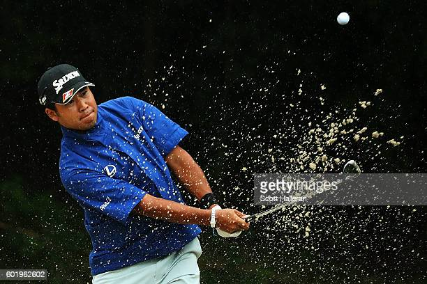 Hideki Matsuyama of Japan hits from a green side bunker on the fourth hole during the third round of the BMW Championship at Crooked Stick Golf Club...