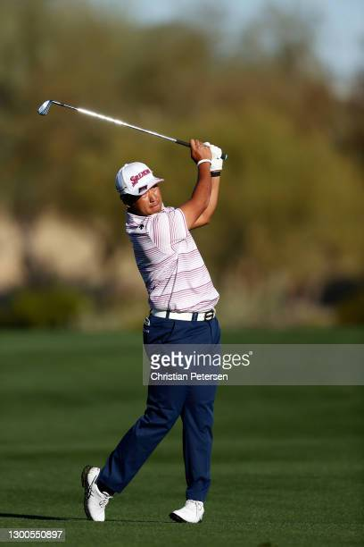 Hideki Matsuyama of Japan hits his second shot on the 14th hole during the second round of the Waste Management Phoenix Open at TPC Scottsdale on...