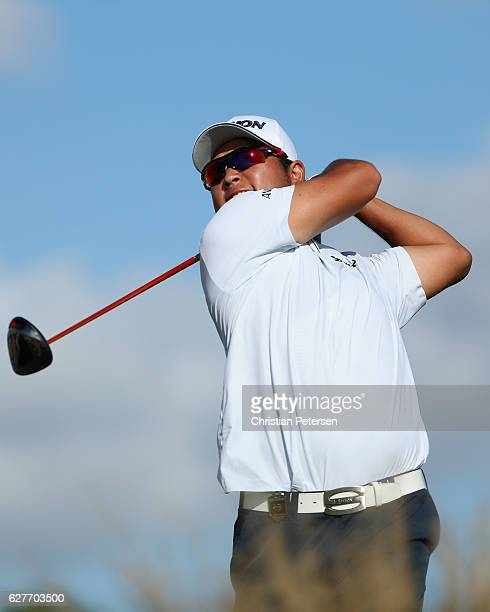 Hideki Matsuyama of Japan hits his tee shot on the 13th hole during the final round of the Hero World Challenge at Albany The Bahamas on December 4...