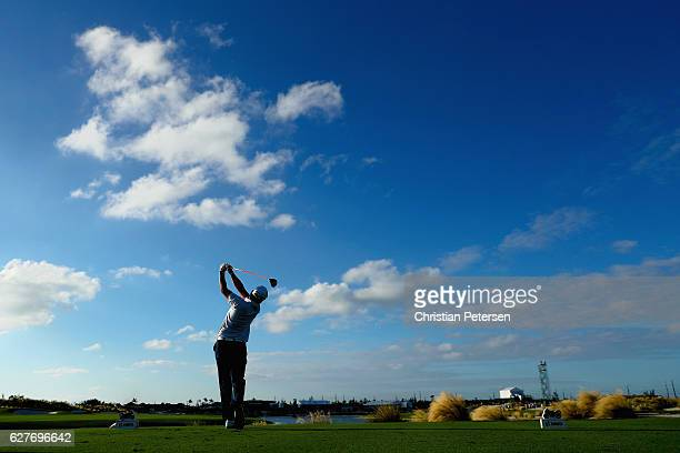 Hideki Matsuyama of Japan hits his tee shot on the 18th hole during the final round of the Hero World Challenge at Albany The Bahamas on December 4...