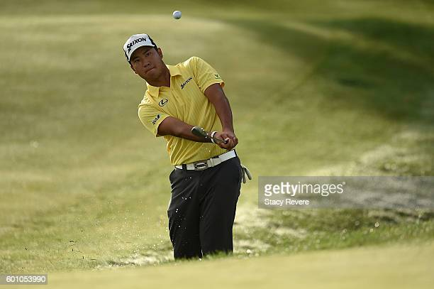 Hideki Matsuyama of Japan hits his third shot on the 15th hole during a continution of the first round of the BMW Championship at Crooked Stick Golf...