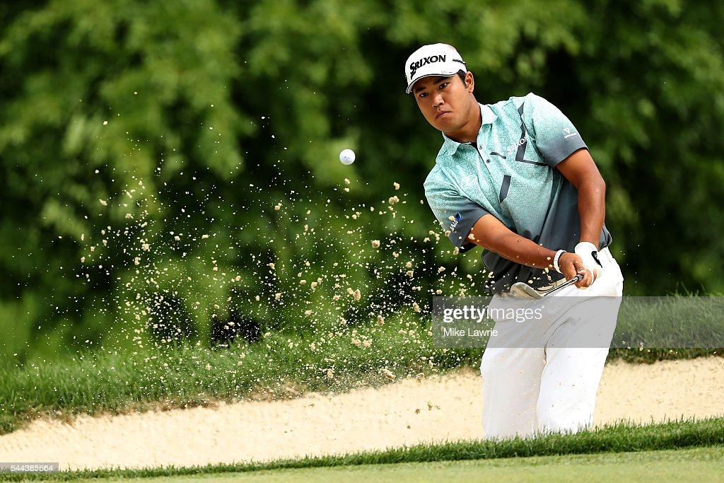 Hideki Matsuyama of Japan hits out of a bunker on the fifth hole during the final round of the World Golf Championships - Bridgestone Invitational at Firestone Country Club South Course on July 3, 2016 in Akron, Ohio. (Photo by Mike Lawrie/Getty Images).