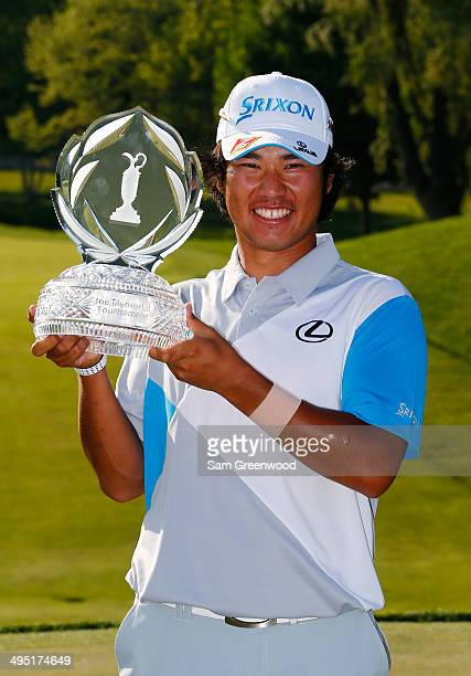 Hideki Matsuyama of Japan holds the trophy after winning the Memorial Tournament presented by Nationwide Insurance in a playoff with Kevin Na at...